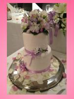wedding cake lilac flowers and petals