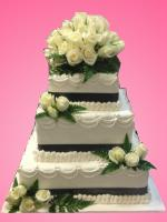 wedding cake white roses and lace